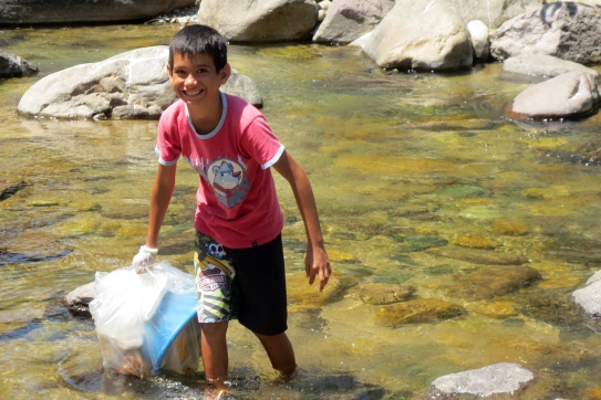 Cleaning in the Rio Cuale