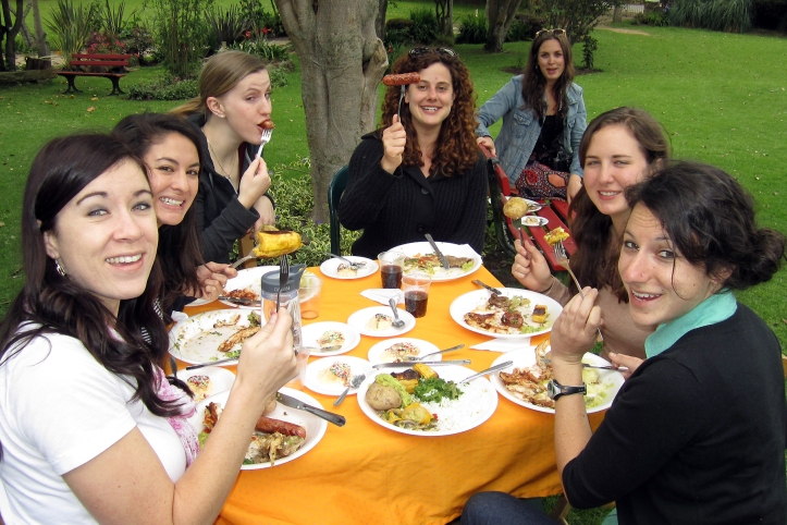 Katie and Jena demonstrate sausage-eating at the asado girls' table